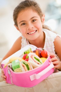 Girl with packed lunch 5 creative ways to make your kids sack lunch more fun
